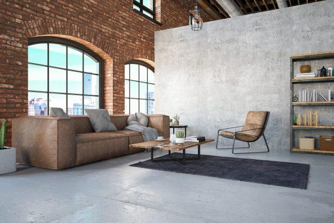 Gemütlicher Loftraum mit Beton-Raumteiler-Wand
